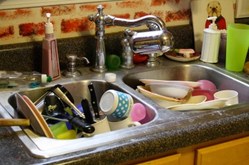 piled-up-dishes-in-kitchen-sink
