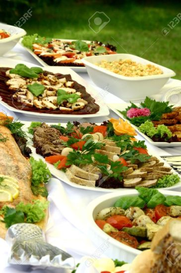 1349490-View-at-delicious-platters-standing-together-on-smorgasbord-Stock-Photo